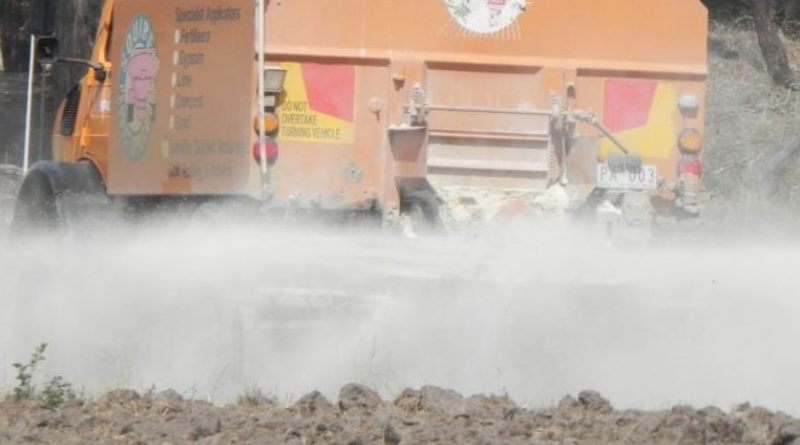 lime is spread from a truck